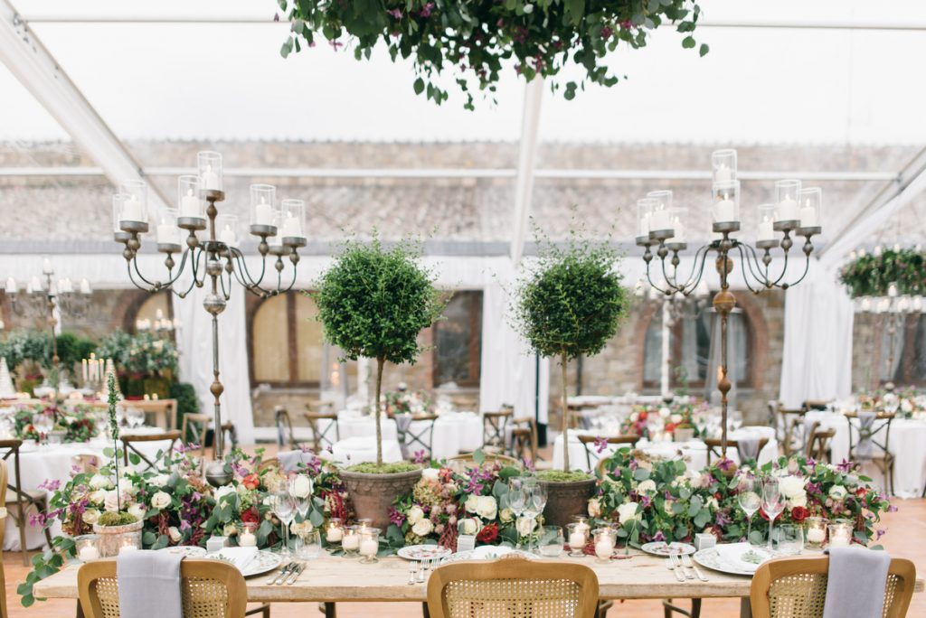 lush and floral decor for bare table tuscan dinner. destination wedding in tuscany