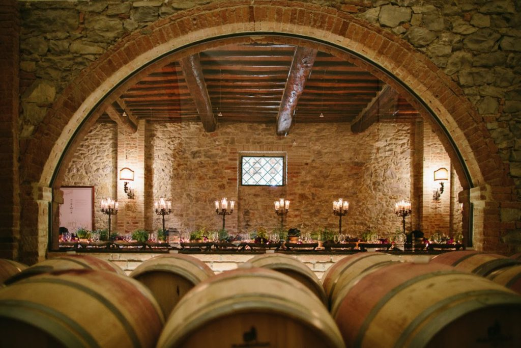 Wedding dinner in a Tuscan Cellar. Destination wedding in Tuscany