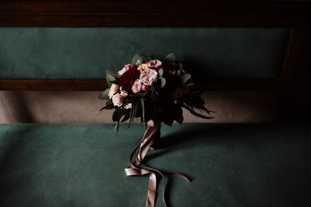 bridal bouquet deep read flowers. jewish wedding in florence
